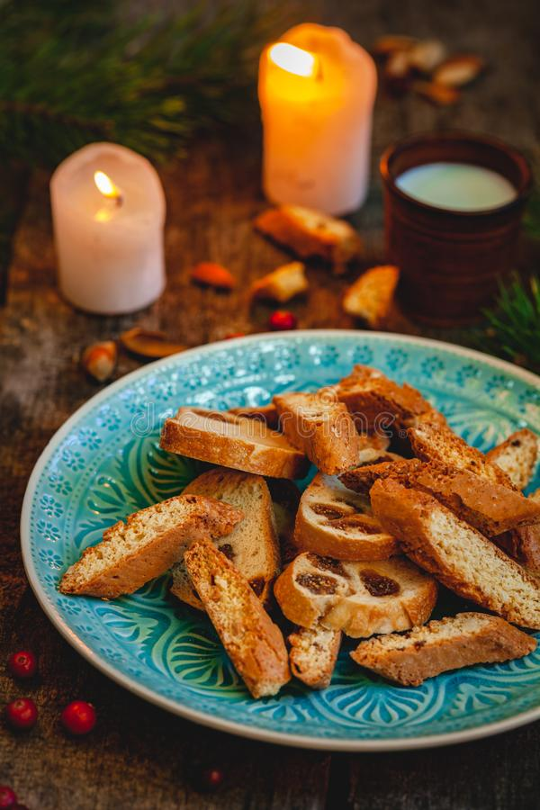 Biscotti or cantucci with milk on wooden rustic table. Christmas food concept. Biscotti or cantucci with milk on wooden rustic table. Close up. Christmas food stock images
