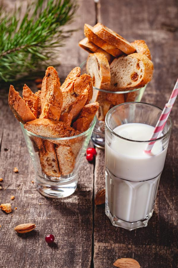Biscotti or cantucci with milk on wooden rustic table. Christmas or New Year food concept. Biscotti or cantucci with milk on wooden rustic table. Close up royalty free stock photo