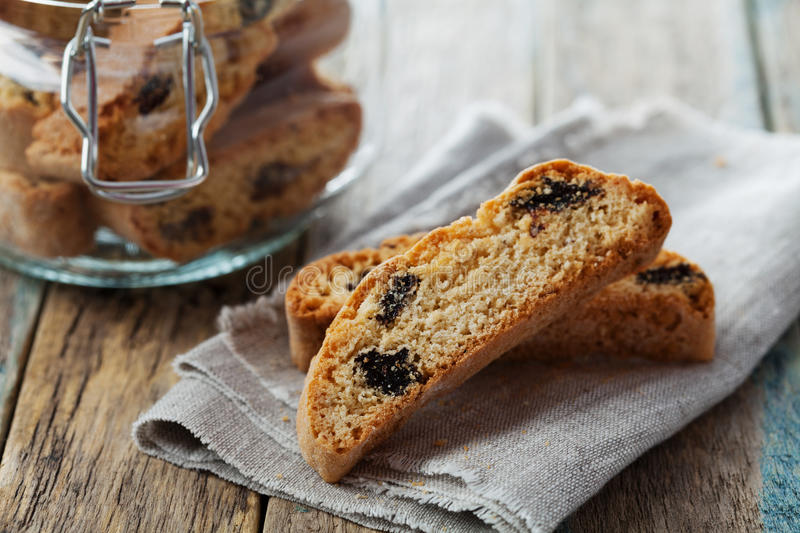 Biscotti or cantucci with raisins on wooden rustic table, traditional Italian biscuit stock photography