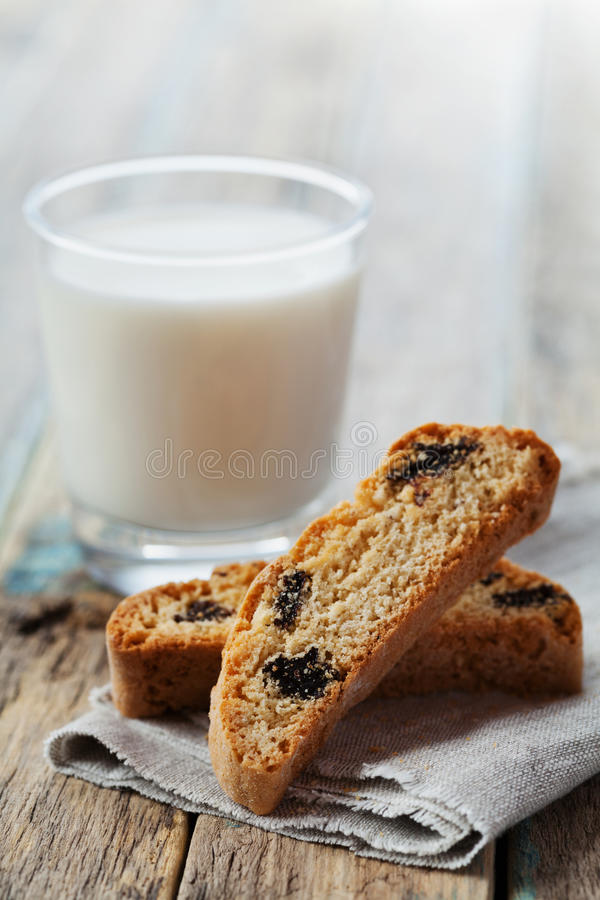 Biscotti or cantucci with raisins on wooden rustic table, traditional Italian biscuit stock image