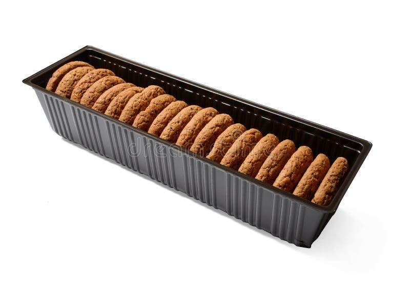 Biscotti di farina d'avena nell'imballaggio di plastica Fondo isolato bianco Primo piano immagine stock