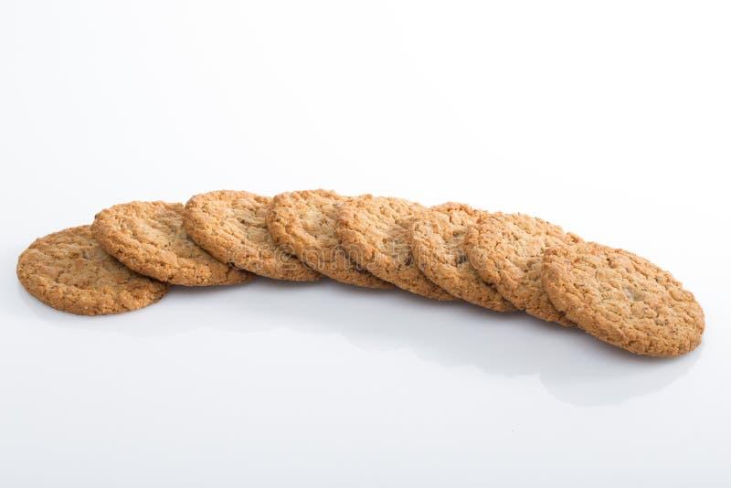 Biscotti di farina d'avena nella linea immagini stock