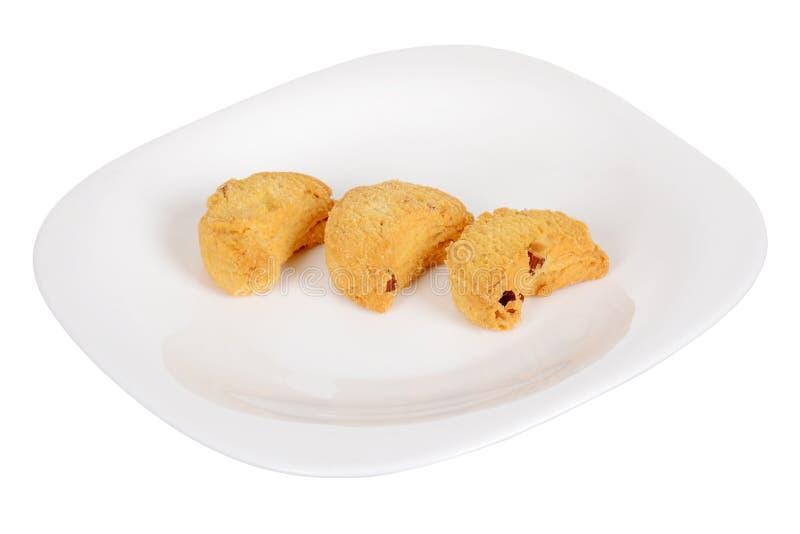 Biscotti di mandorla dolce isolati su fondo bianco immagine stock libera da diritti