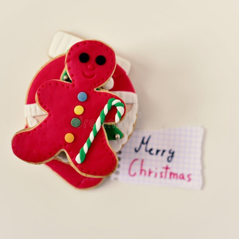Biscotti di Natale e Buon Natale del testo fotografie stock