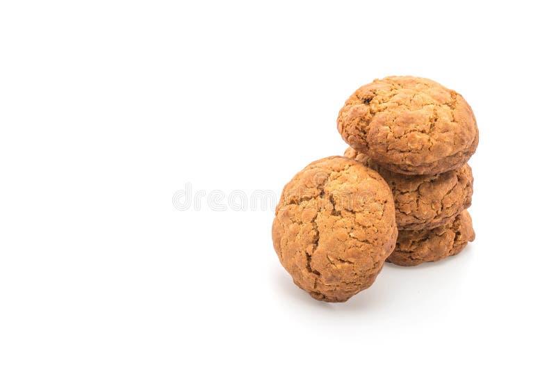 Biscotti di uva passa della farina d'avena su bianco immagine stock