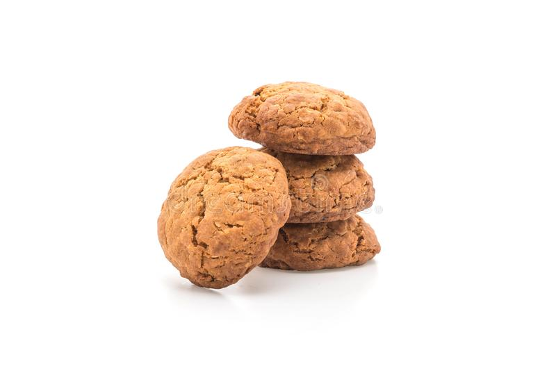 Biscotti di uva passa della farina d'avena su bianco fotografie stock