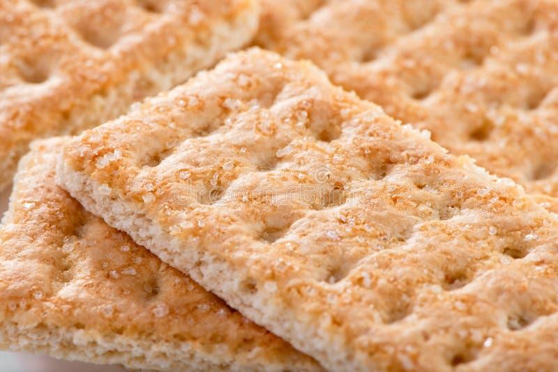 Biscotti dolci di Galette con i grani di macro colpo dello zucchero fotografie stock