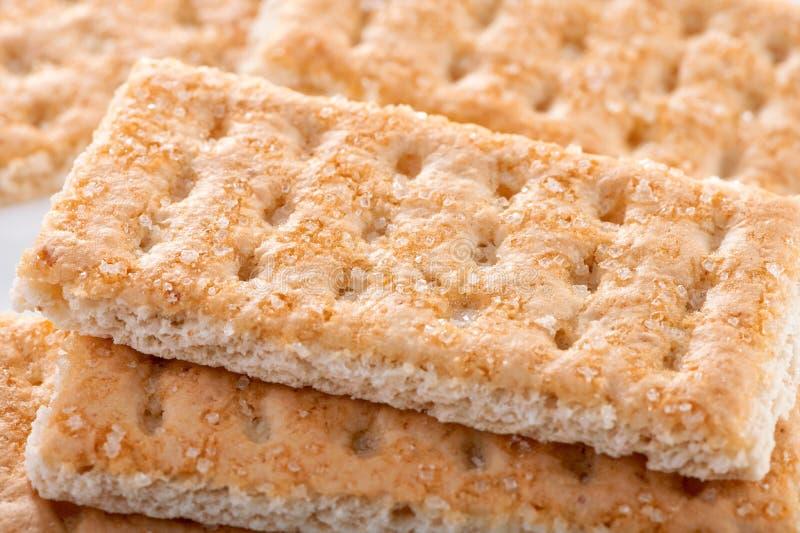 Biscotti dolci di Galette con i grani di macro colpo dello zucchero fotografia stock libera da diritti