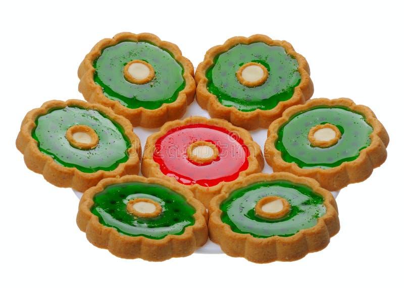 Biscotti sulla zolla bianca, isolata immagine stock