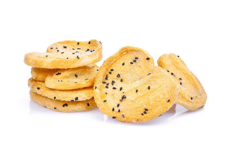 Biscotto con sesamo nero su bianco fotografia stock