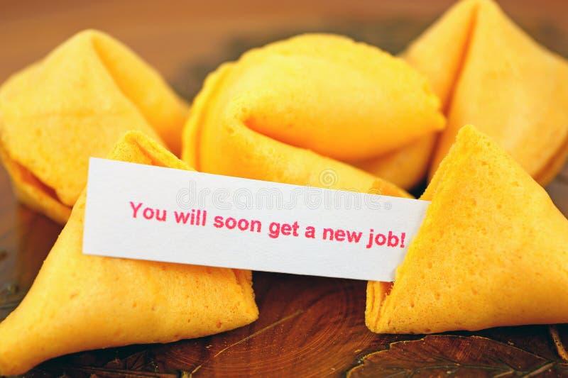 Biscotto di fortuna con la previsione di job   fotografia stock libera da diritti