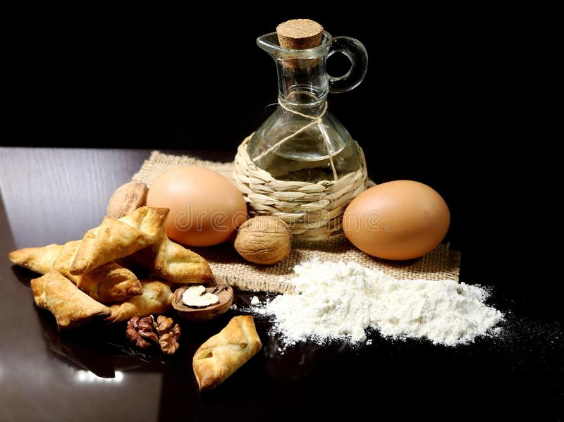 Biscuit. Bakery products. Homemade cookies. The process of preparing the dough. Flour. Eggs. Walnuts. Coconut oil. Cooking. Homema stock photography