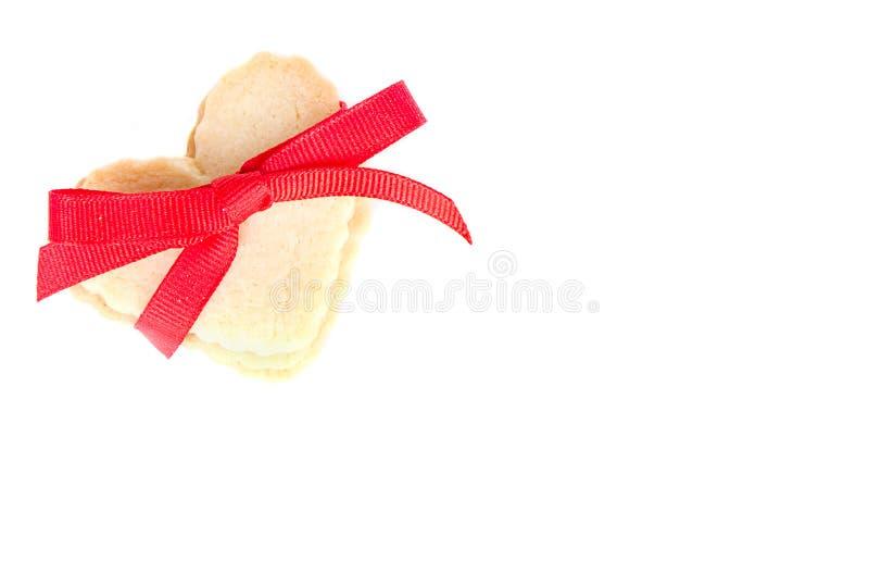 Biscuit en forme de coeur attaché avec la bande photo libre de droits