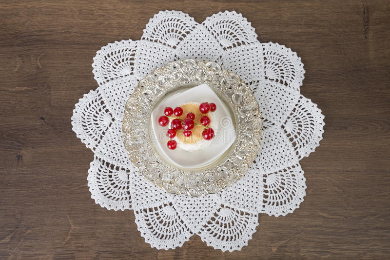Biscuit on plate and doily