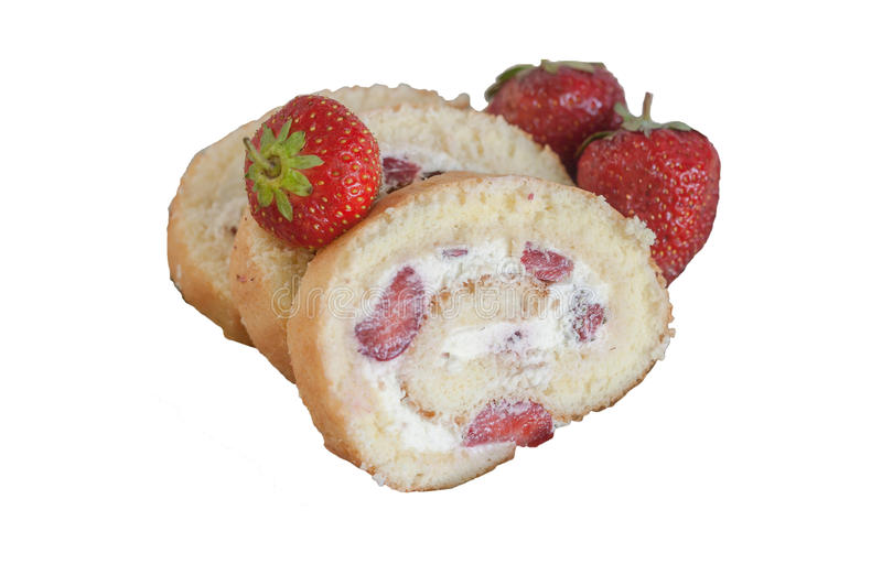 Biscuit roll with cream and fresh strawberries, close-up, isolated on white background royalty free stock images