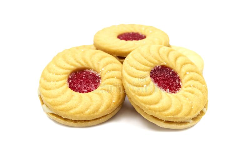 Biscuit sandwich butter cookies with cream and strawberry flavoured jam. stock photo