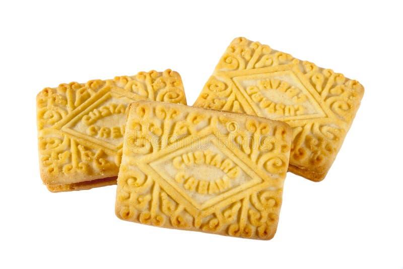 Biscuits crèmes de crème anglaise au-dessus d'un fond blanc simple photo stock
