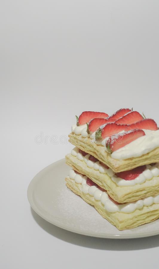 Biscuits With Cream and Sliced Strawberry Toppings royalty free stock photos
