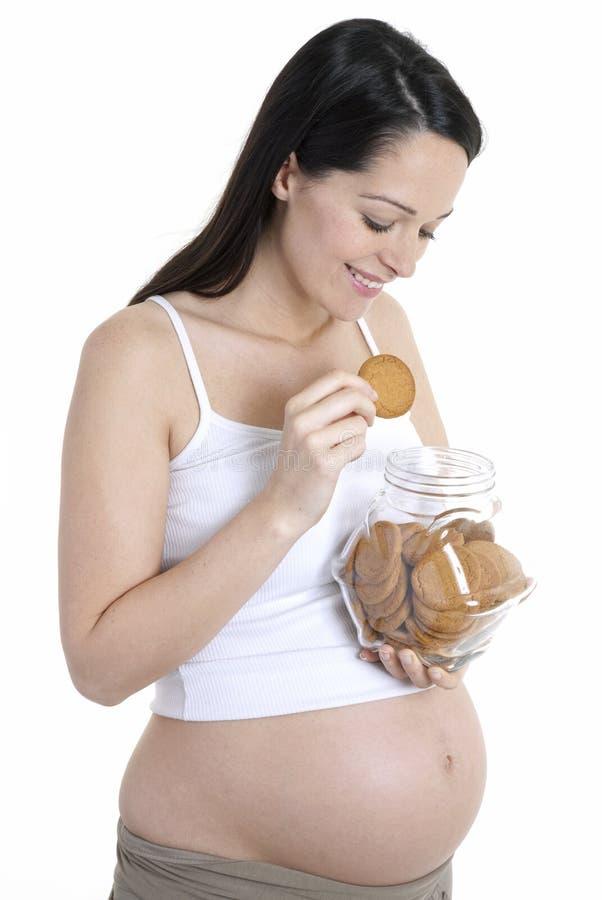 Biscuits de femme de grossesse photos stock