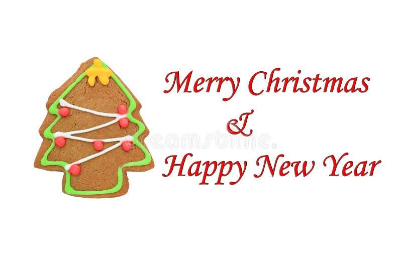 Biscuits de Noël d'isolement sur le fond blanc avec le Joyeux Noël et la bonne année des textes images libres de droits