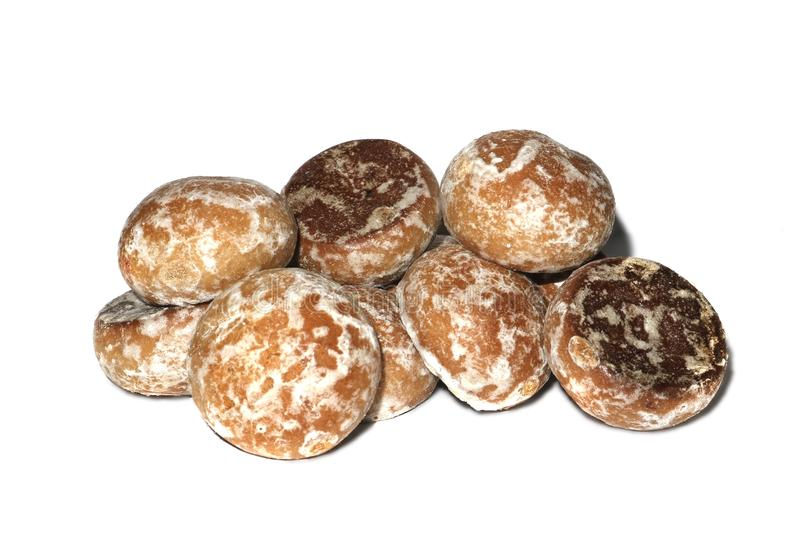 Biscuits de pain d'épice dans le lustre sur un fond blanc photographie stock libre de droits
