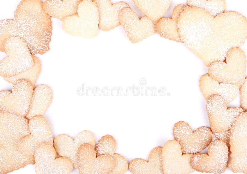 Biscuits en forme de coeur dans la forme de la trame image stock