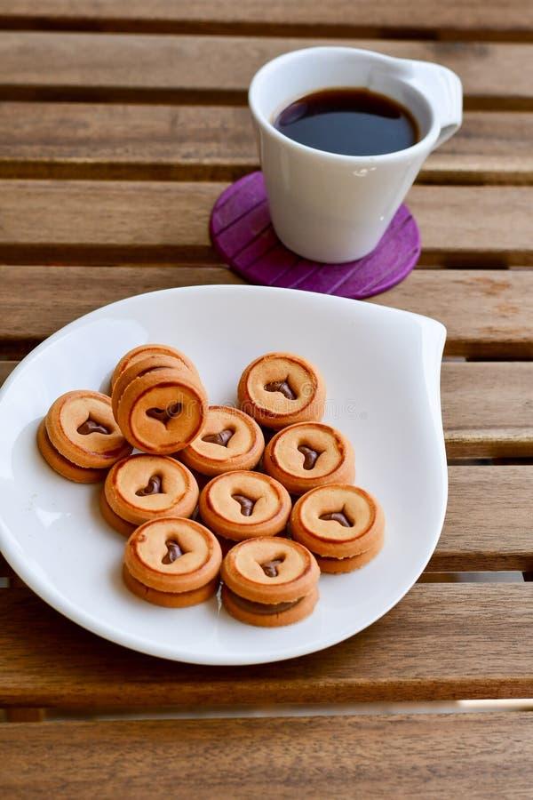 Biscuits et café images stock