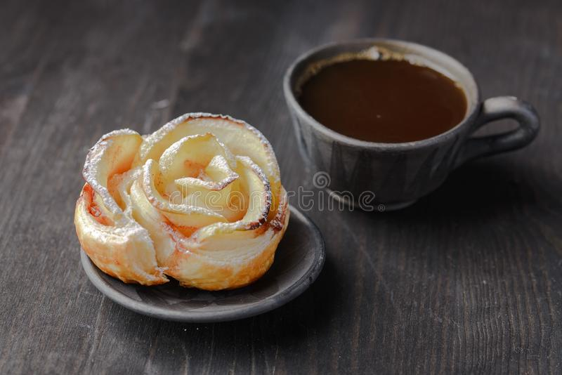 Biscuits with jam. Cup of coffee and a bun in the form of a rose,homemade buns with jam,homemade baking,puff pastries with a cup of coffee stock photography