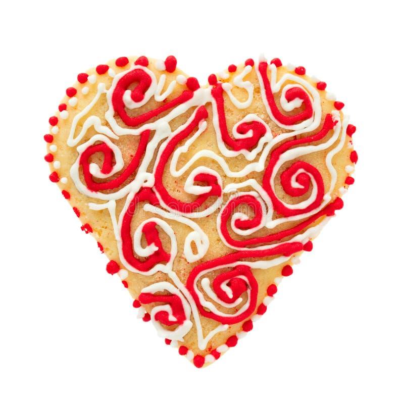 Biscuits sablés de la pâte sous forme de coeur, décoré du glaçage photographie stock libre de droits