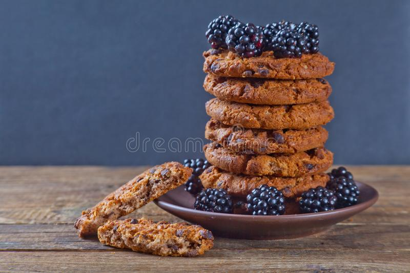 Biscuits on a saucer with blackberry royalty free stock images