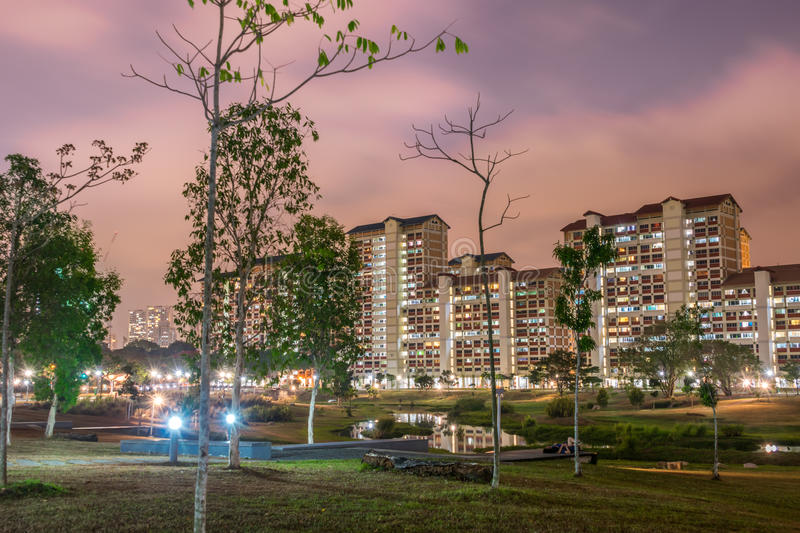 Bishan Park. HDB high rise housing in singapore along the park.Beautiful colorful night stock photos