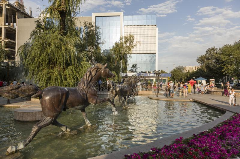 Bishkek, Kyrgyzstan August 9 2018: Pedestrian area with fountain in Bishkek City. Bishkek, Kyrgyzstan August 9 2018: Pedestrian area with fountain in the center royalty free stock images