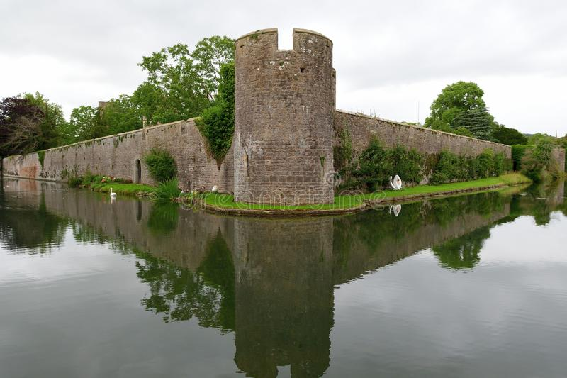 Bishops palace in Wells. View of the moat and boundary wall of the Bishops palace in Wells in Somerset royalty free stock image