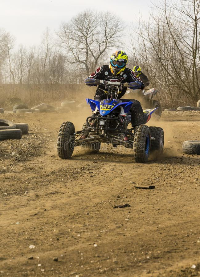 The man riding a leisure quad bike on the off-road. royalty free stock images
