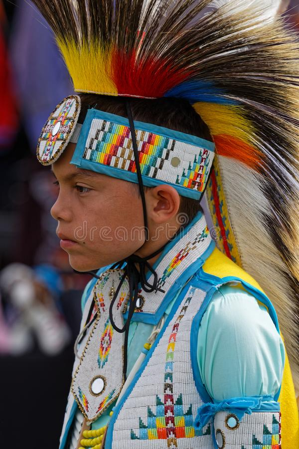 Portrait of a young dancer of the 49th annual United Tribes Pow Wow. BISMARK, NORTH DAKOTA, September 9, 2018 : A dancer of the 49th annual United Tribes Pow Wow stock images