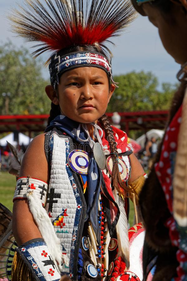 Child dancer of the 49th annual United Tribes Pow Wow. BISMARK, NORTH DAKOTA, September 8, 2018 : A dancer of the 49th annual United Tribes Pow Wow, one large royalty free stock images