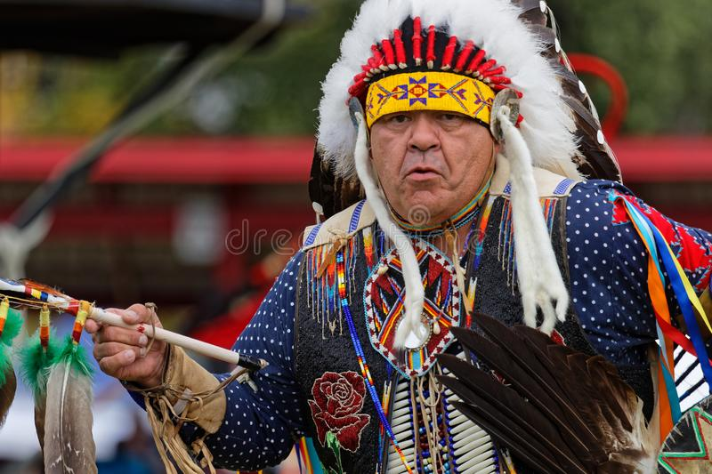 Old dancer at the 49th annual United Tribes Pow Wo. BISMARK, NORTH DAKOTA, September 9, 2018 : A dancer of the 49th annual United Tribes Pow Wow, one large royalty free stock photo
