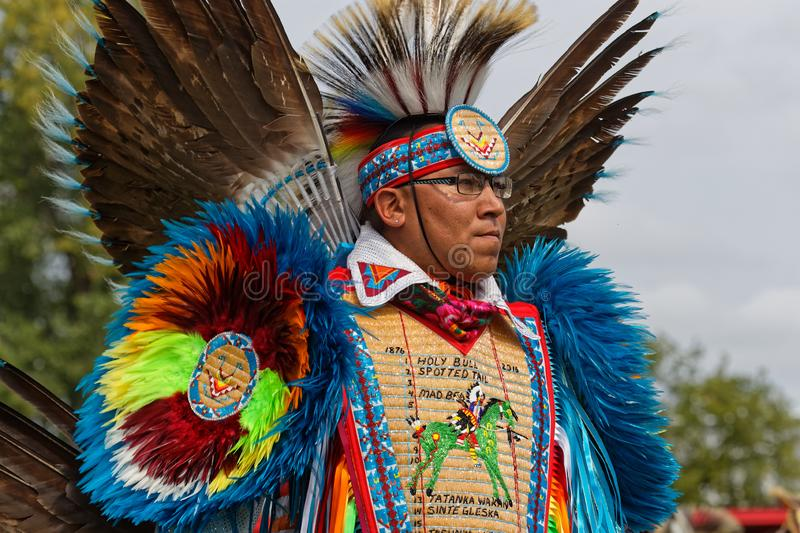 Blue fancy dancer at the 49th annual United Tribes Pow Wow. BISMARK, NORTH DAKOTA, September 9, 2018 : A dancer of the 49th annual United Tribes Pow Wow, one royalty free stock photos