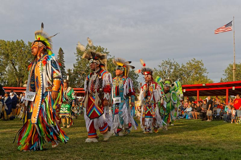 Men at Grand Entry of the 49th annual United Tribes Pow Wow. BISMARK, NORTH DAKOTA, September 8, 2018 : Grand Entry of the 49th annual United Tribes Pow Wow, one royalty free stock image