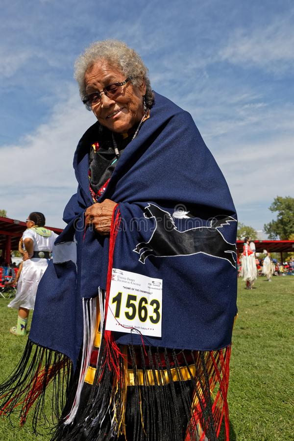 Old woman at the 49th annual United Tribes Pow Wow. BISMARK, NORTH DAKOTA, September 8, 2018 : Old woman at the 49th annual United Tribes Pow Wow, one large royalty free stock photography