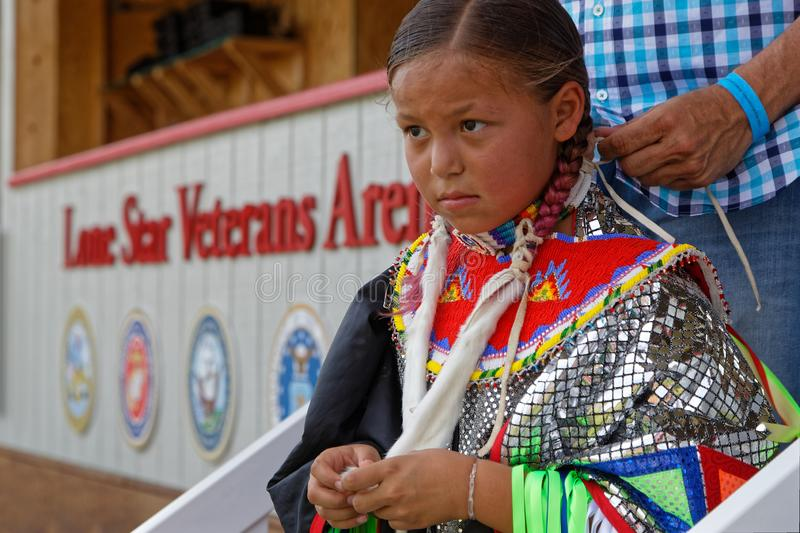 Preparation for a young girl at the Pow Wow. BISMARK, NORTH DAKOTA, September 8, 2018 : Preparation for the 49th annual United Tribes Pow Wow, one large outdoor royalty free stock image