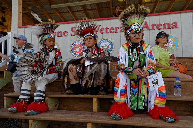 Boys waiting for dances at the 49th annual United Tribes Pow Wow. BISMARK, NORTH DAKOTA, September 8, 2018 : 49th annual United Tribes Pow Wow, one of largest royalty free stock image