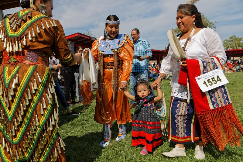 Baby girl and family at 49th annual United Tribes Pow Wow. BISMARK, NORTH DAKOTA, September 8, 2018 : 49th annual United Tribes Pow Wow, one of largest outdoor royalty free stock images