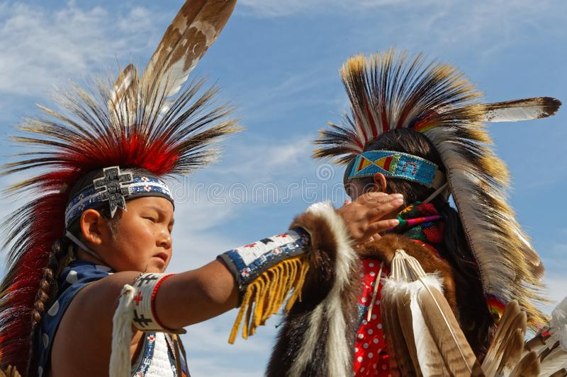Young friends at the 49th annual United Tribes Pow Wow. BISMARK, NORTH DAKOTA, September 8, 2018 : 49th annual United Tribes Pow Wow, one of largest outdoor stock photos