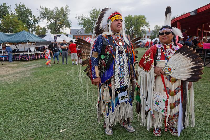 Man and woman outside the arena of 49th annual United Tribes Pow Wow. BISMARK, NORTH DAKOTA, September 8, 2018 : 49th annual United Tribes Pow Wow, one of royalty free stock photo