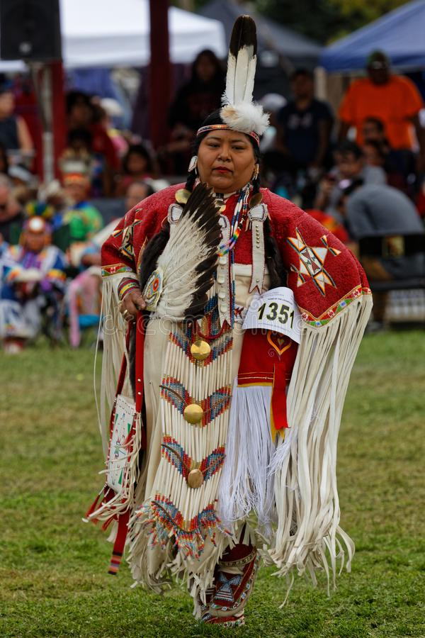 Woman in red dancing for the 49th annual United Tribes Pow Wow. BISMARK, NORTH DAKOTA, September 9, 2018 : Woman dancer of the 49th annual United Tribes Pow Wow royalty free stock photos
