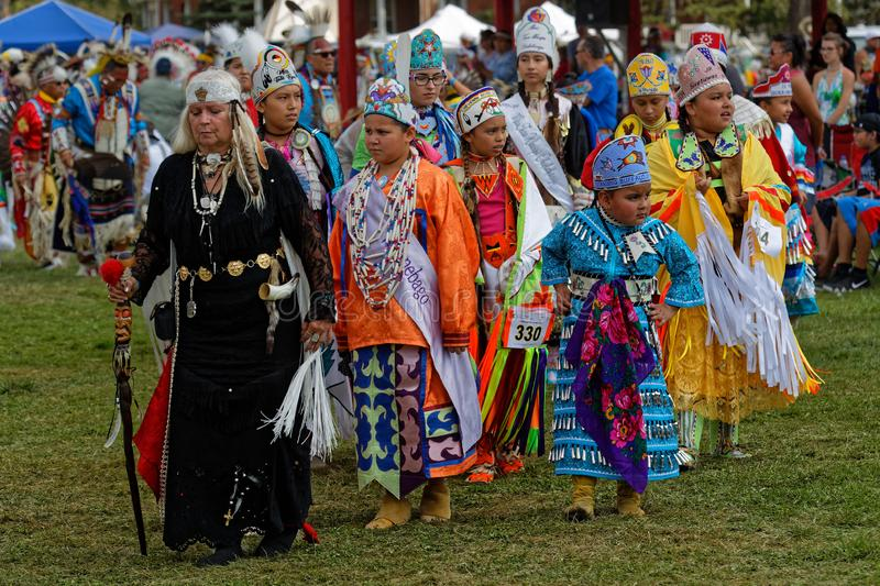 Women and children dancers of the 49th annual United Tribes Pow Wow. BISMARK, NORTH DAKOTA, September 9, 2018 : Women dancers of the 49th annual United Tribes stock photography