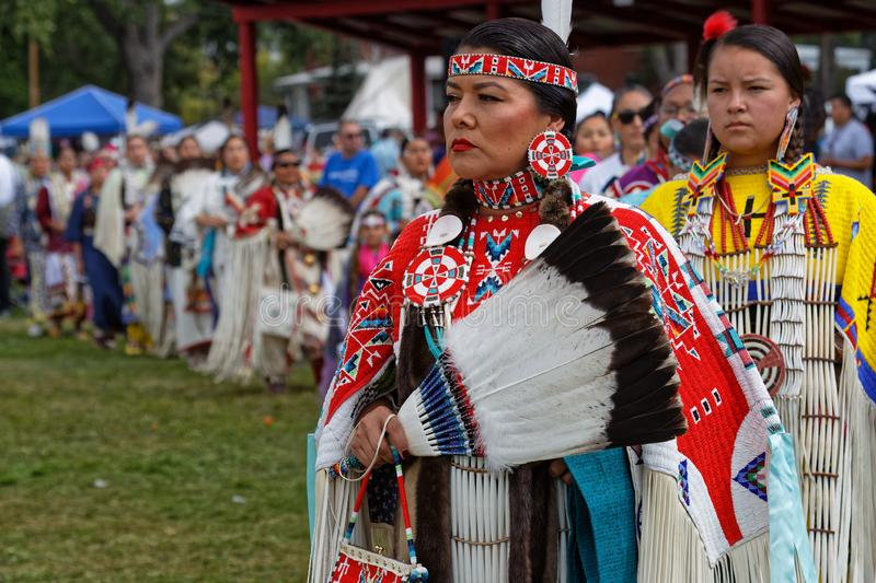 Women dancers in a raw at the 49th annual United Tribes Pow Wow. BISMARK, NORTH DAKOTA, September 9, 2018 : Women dancers of the 49th annual United Tribes Pow royalty free stock photography