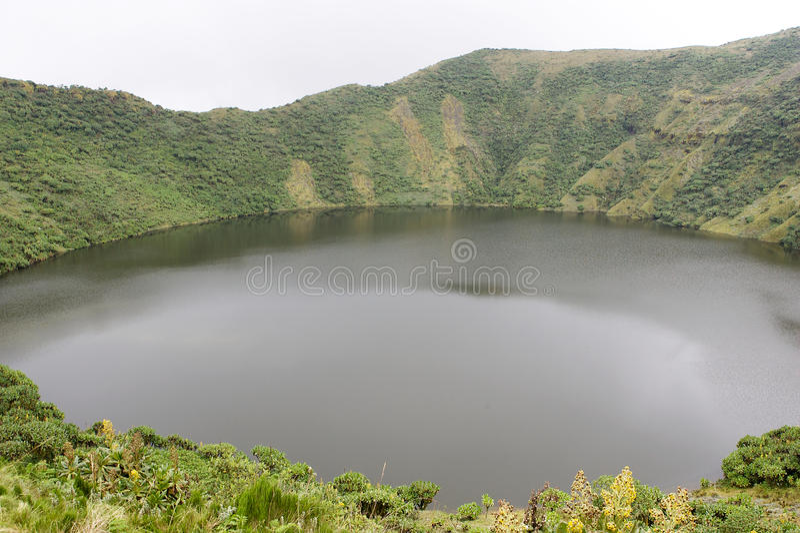 Bisoke crater lake. Rwanda: Mount Bisoke, also Visoke, is an extinct volcano in the Virunga Mountains of the Great Rift Valley. It straddles the border of Rwanda stock photography