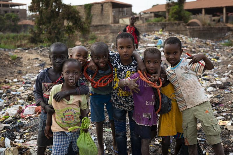 Group of children at a landfill in the city of Bissau, in Guinea-Bissau. Bissau, Republic of Guinea-Bissau - February 8, 2018: Group of children at a landfill in royalty free stock photos